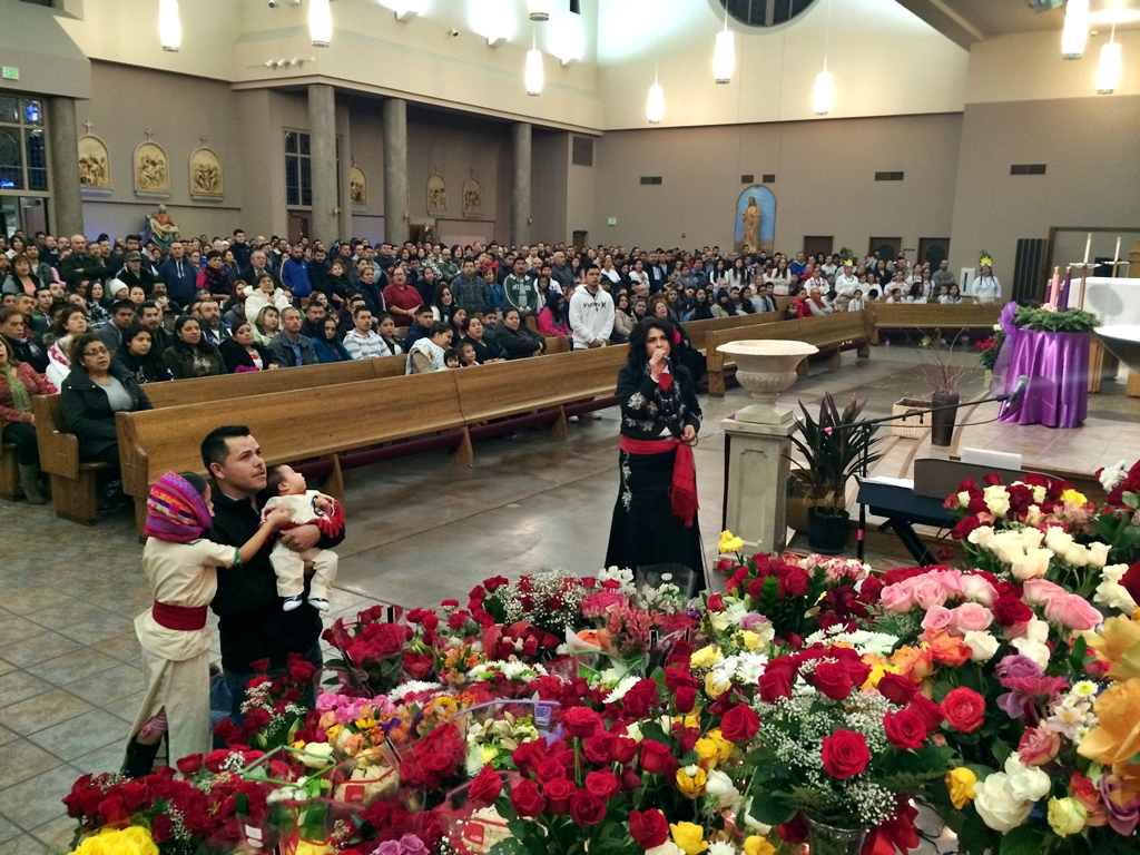 Parishioners kneel before a portrait of the Virgen de Guadalupe at St. Joseph s church in Yakima